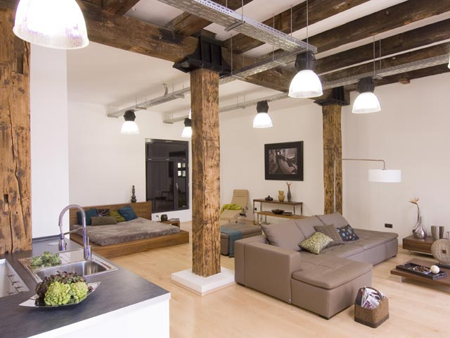 Select furniture that is appropriate for the space; a sectional couch like this helps separate the space in this huge loft.